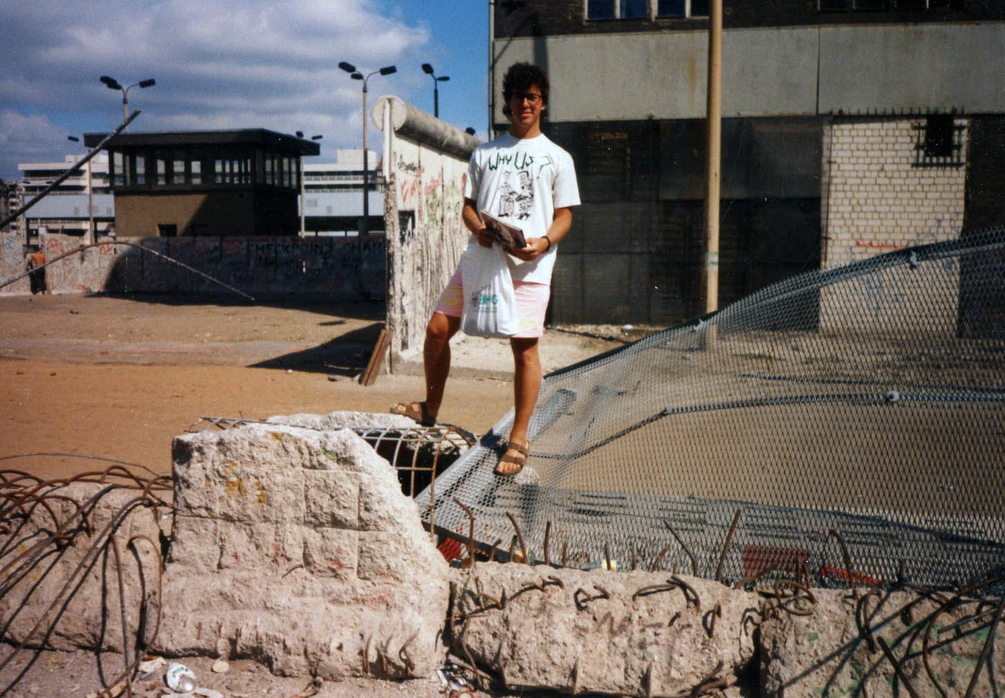 Victorious - Atop a small section of The Berlin Wall - July 1990.