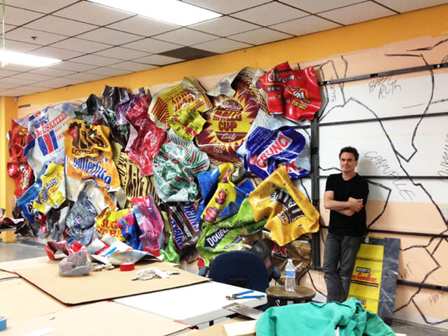 Paul next to his wrapper work-in-progress.