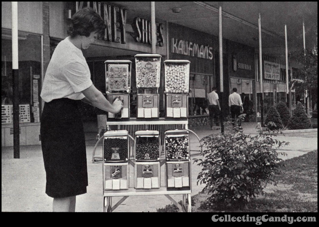 Woman at candy and gum vending machines circa 1969